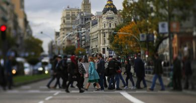 people-crossing-street-madrid-spain